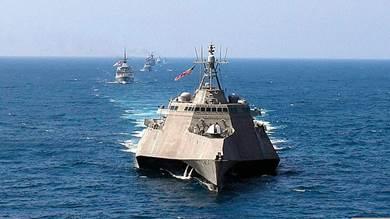 اسطول يتبع البحرية الصينية في استعراض قوة خلال المناورات الامريكية مع دول اسيان